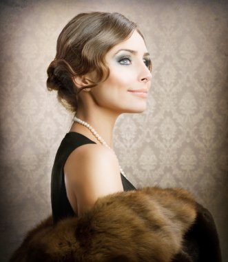 Beautiful Woman. Retro Styled Soft Portrait