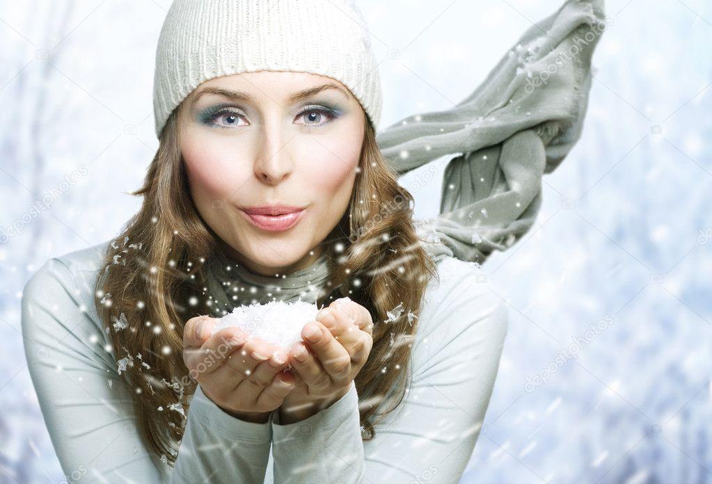 Christmas Girl. Winter woman Blowing Snow — Stock Photo ...