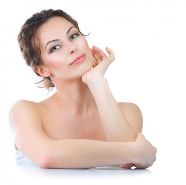 Beautiful Young Woman. Skincare .Perfect Skin. Spa isolated on a white background