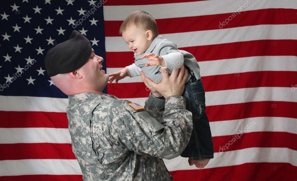 American Soldier holds his infant son