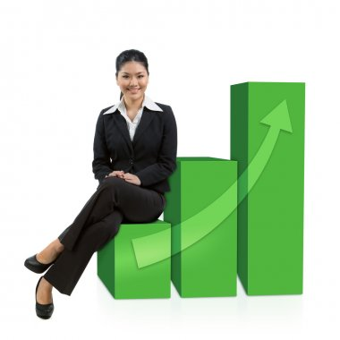 Successful business woman sitting on graph