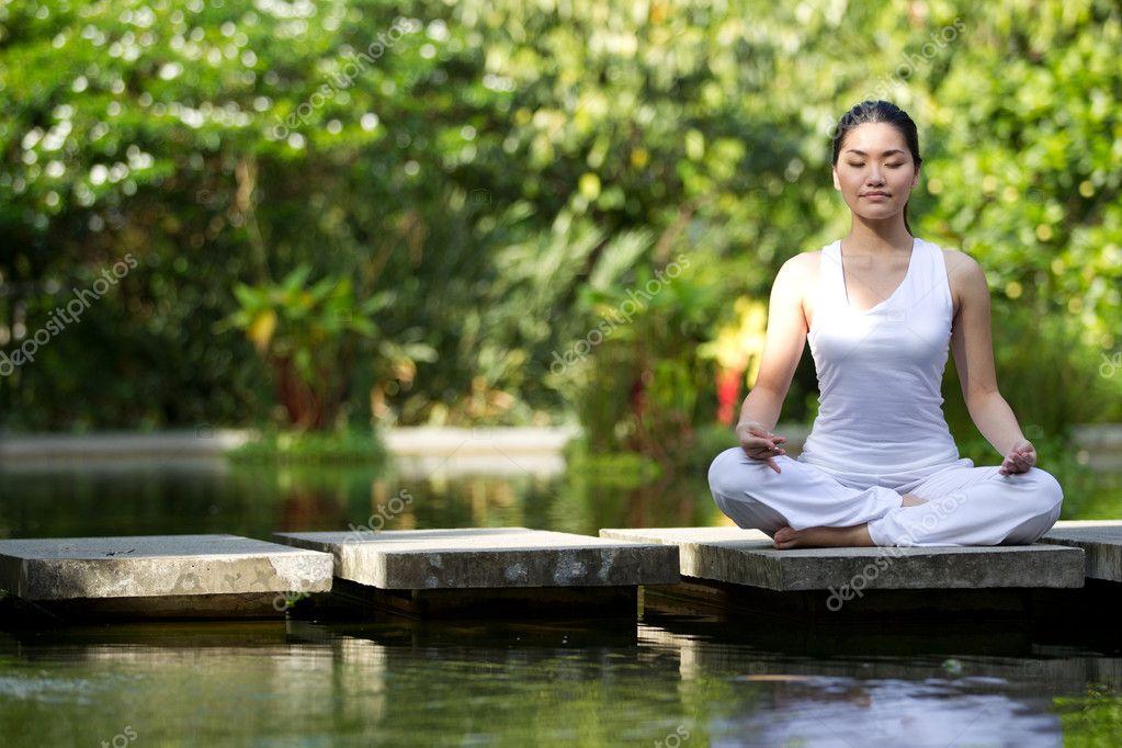 Asian Woman performing yoga