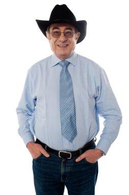 Portrait of a senior cowboy wearing hat
