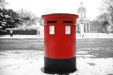 Snow covered traditional british post box