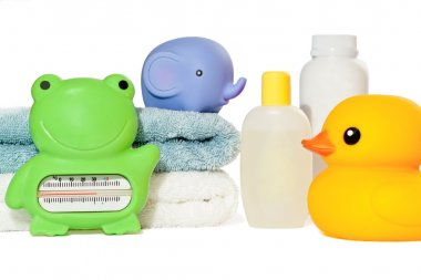 Baby bath accessories isolated: towels, toys, thermometer and bo