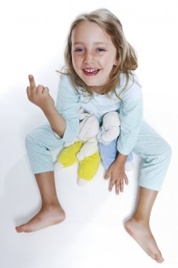 Girls in pajamas shows the middle finger