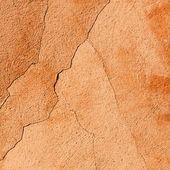 Cracked orange wall texture background