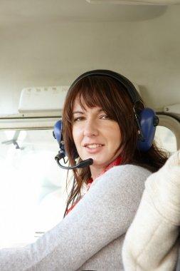 Woman pilot in plane