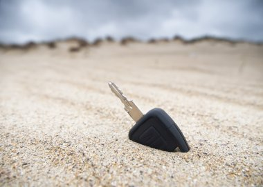 Car key in the sand