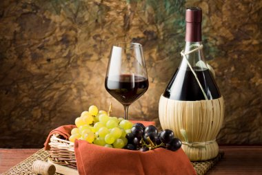 Grapes, bottle and a glass of wine
