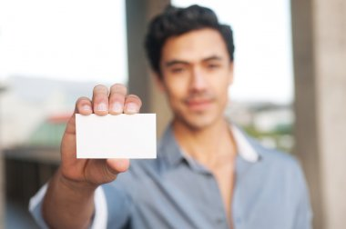 Handsome businessman presenting blank business card