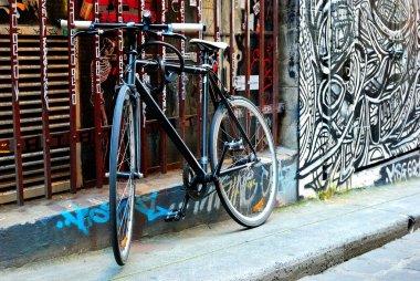 A black bike and urban graffiti in Melbourne