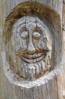 Smiley face carved into a tree