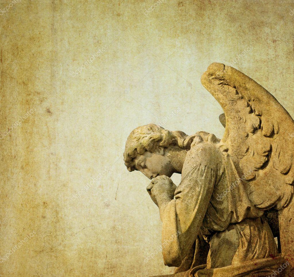 Statue of a stone cherubim angel in a cemetery in london, england