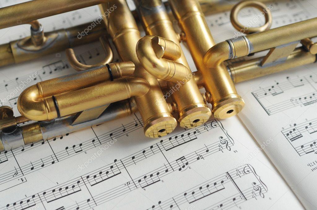 All Music Chords golden sheet music : Beautiful golden trumpet on sheet music — Stock Photo ...