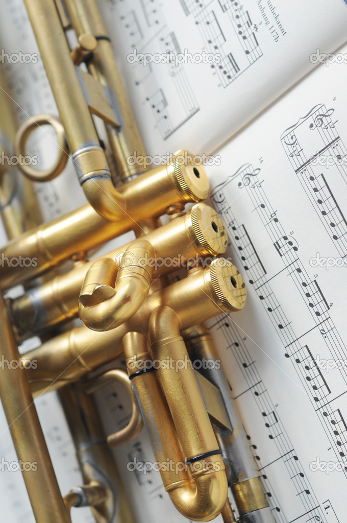 Beautiful golden trumpet on sheet music — Stock Photo ...
