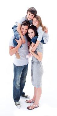 Cheerful parents giving their children piggyback ride