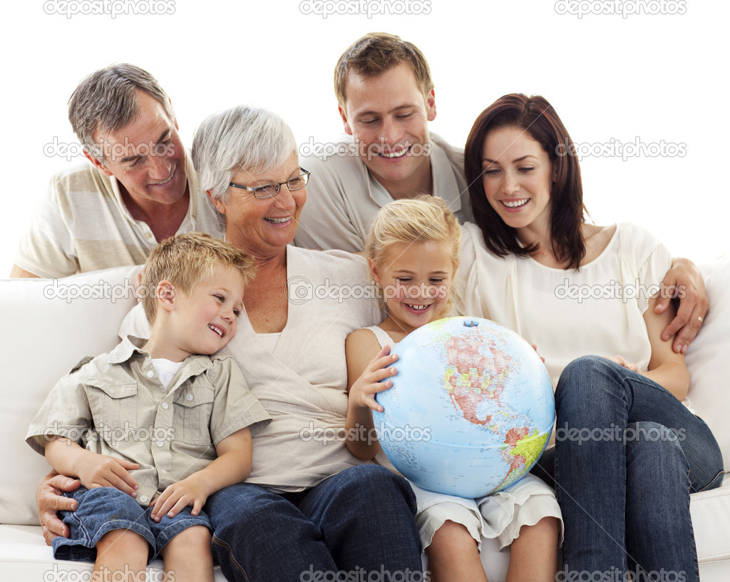 Big Family On Sofa Looking At A Terrestrial Globe U2014 Stock Photo #10297971