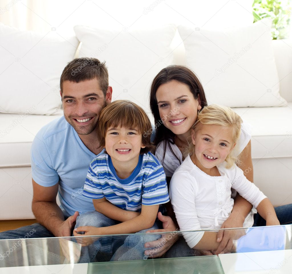Portrait of happy family smiling in living-room ⬇ Stock ...