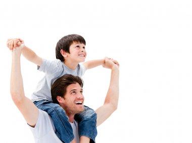 Joyful father giving piggyback ride to his son