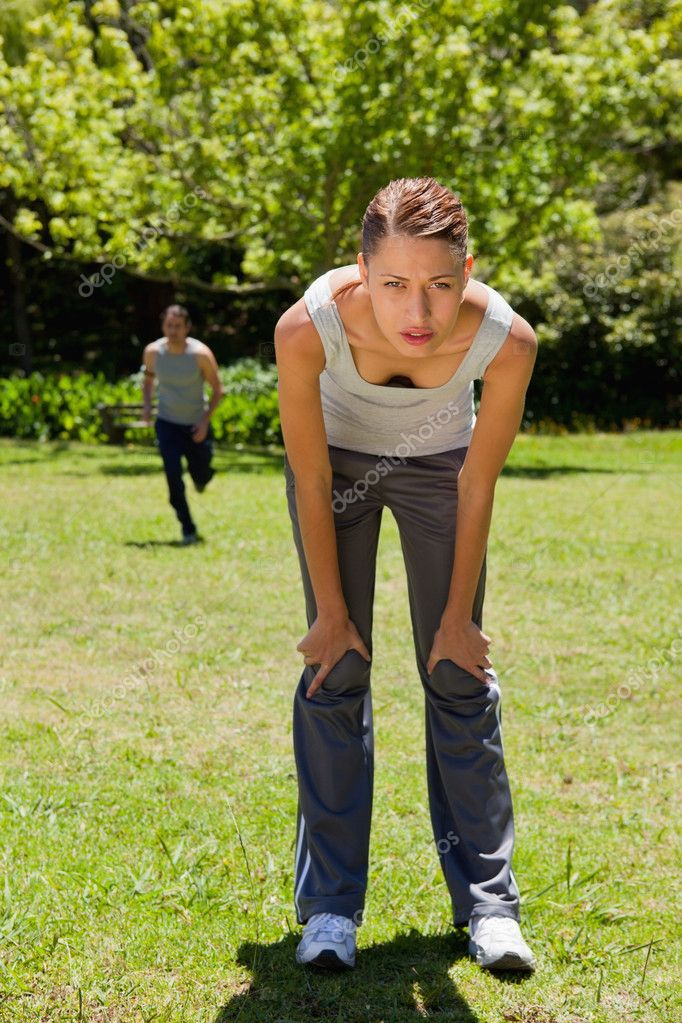Woman bending over while a man is running in the ... |For Man Woman Leaning Forward