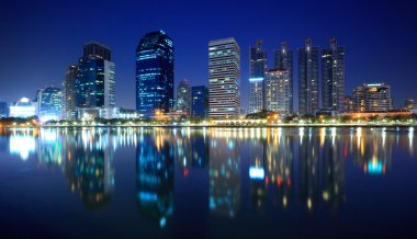 Panorama of Bangkok city at night with reflection of skyline, Ba