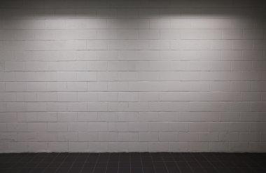 White brick wall pavement with dim lighting