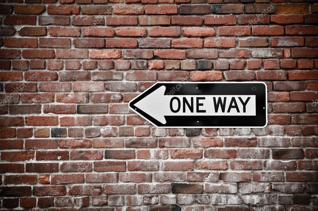 Brick Wall with One Way Sign