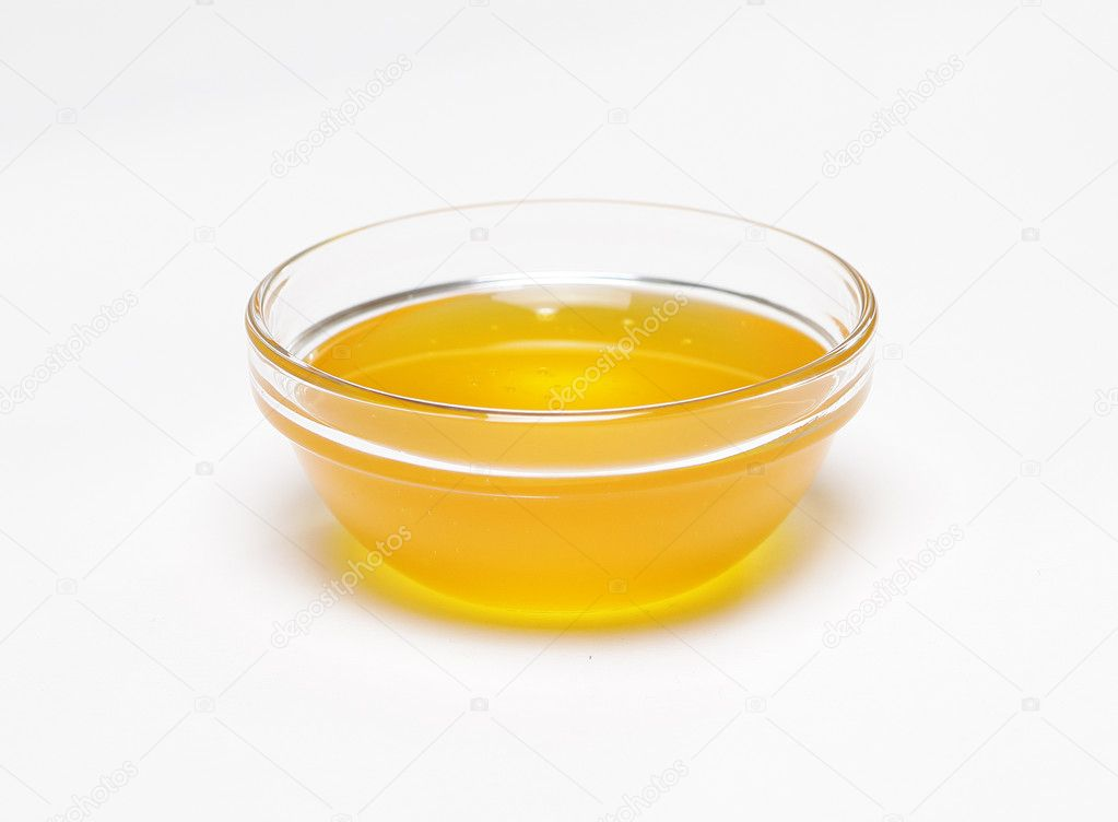A Marble In A Cup Of Honey : Honey in transparent cup — stock photo kuterin
