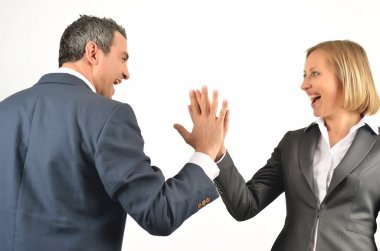 Young business colleagues giving each other a high five isolated