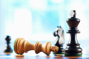 White king wins chess game sepia tone