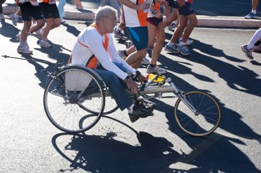 Disabled athletes in wheelchairs in the Run for Food race in Rome