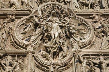 Milan - detail from main bronze gate - Pieta