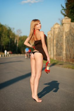 Young sexy girl on road
