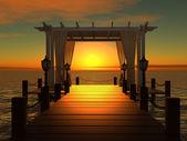 Svatební altán na dřevěném molu do moře s slunce při západu slunce