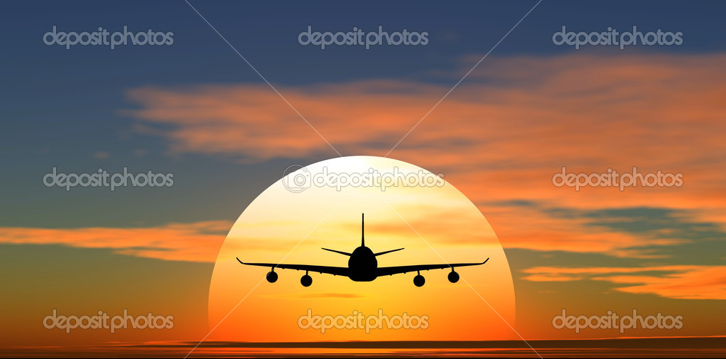 Airplane flying against the background of sunset