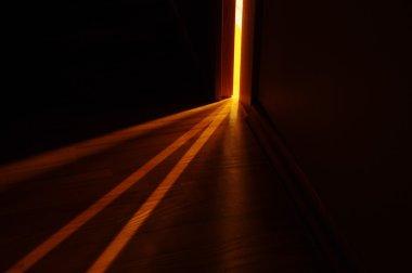 Light shining on the floor through door gap