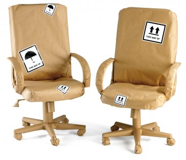 Office chairs wrapped in brown paper ready for a move isolated o