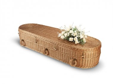 Wicker bio-degradable eco coffin isolated on white with clipping