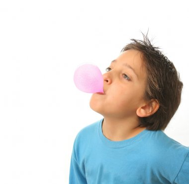 Boy blowing a pink bubble gum