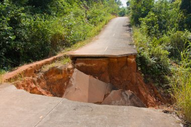 Break of asphalt road