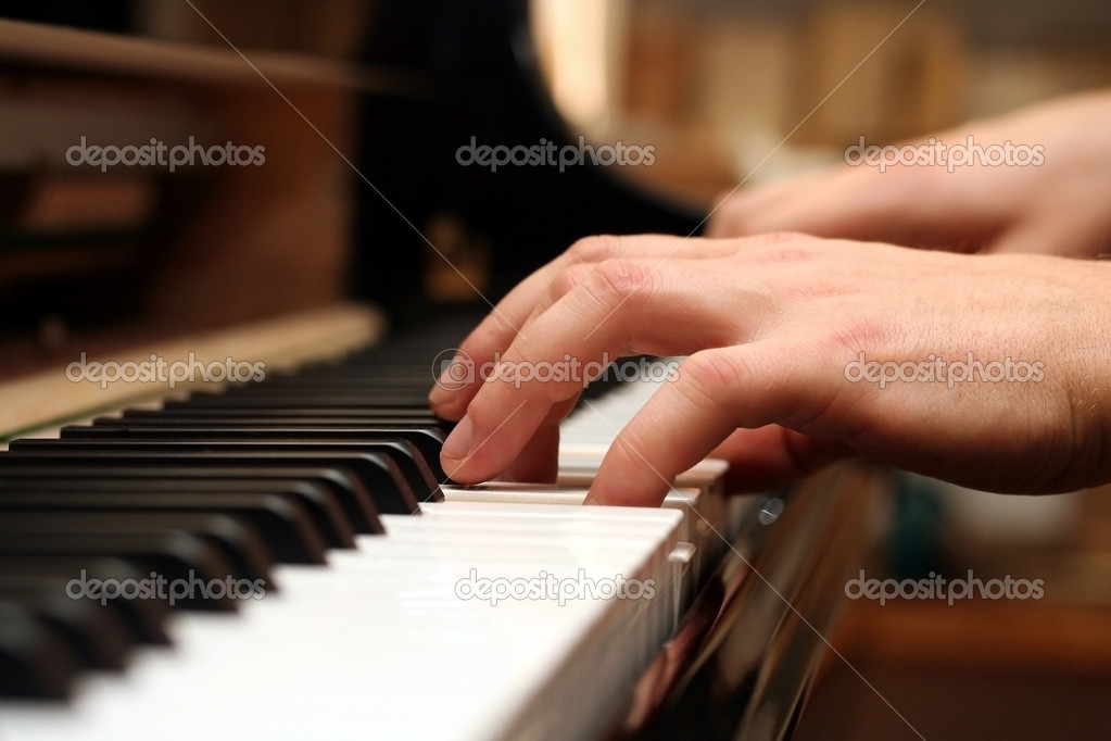 Hands of a piano playing guy