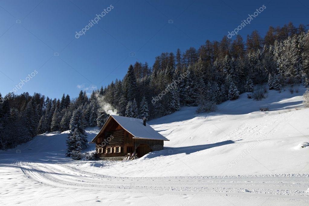 Log cabin in winter
