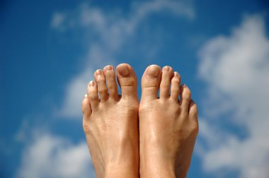 Woman feet and sky