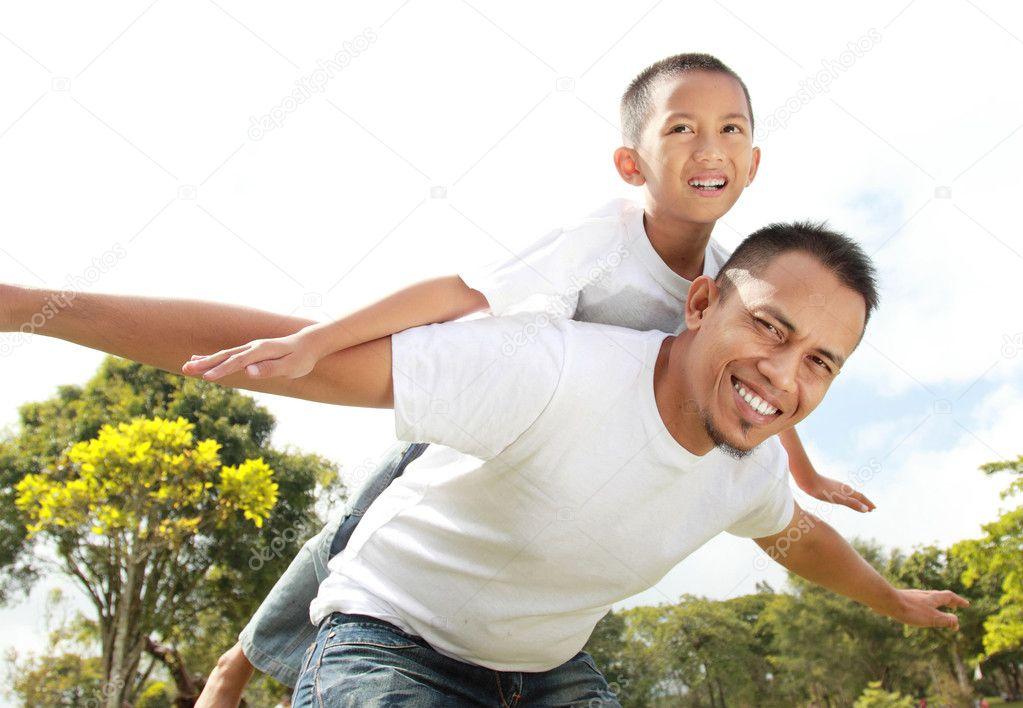 Young boy having piggyback ride