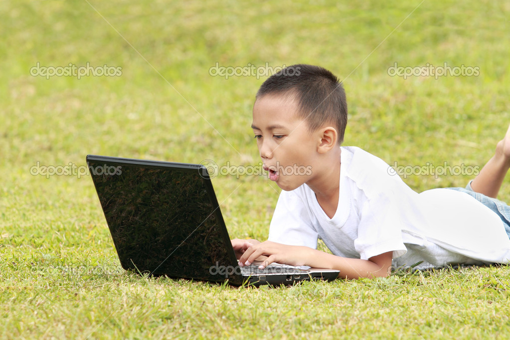 Shocked kid on laptop