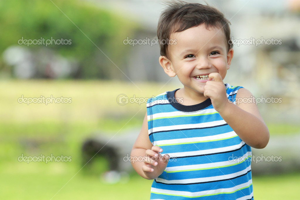 Little boy smiling while running