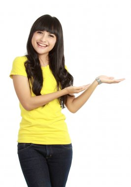 Young woman showing a imaginary product