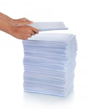 Hand put paper on stack of paper.