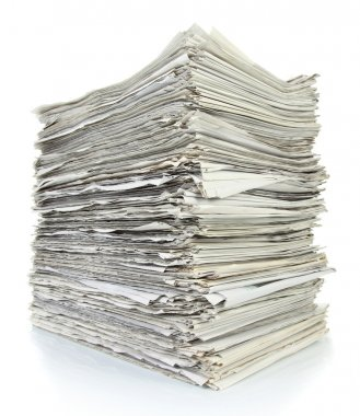 Stack of files full of documents signifying concepts such as wor